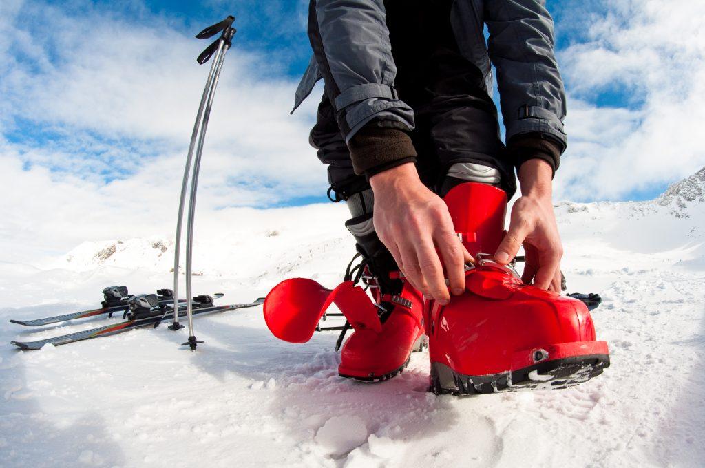 Man Fastening Ski Boots